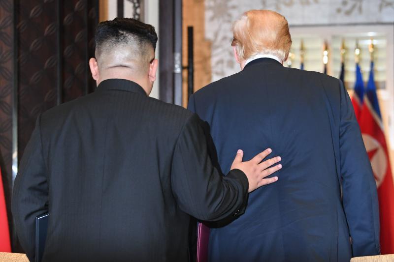 20180612 trump and kim back.jpg
