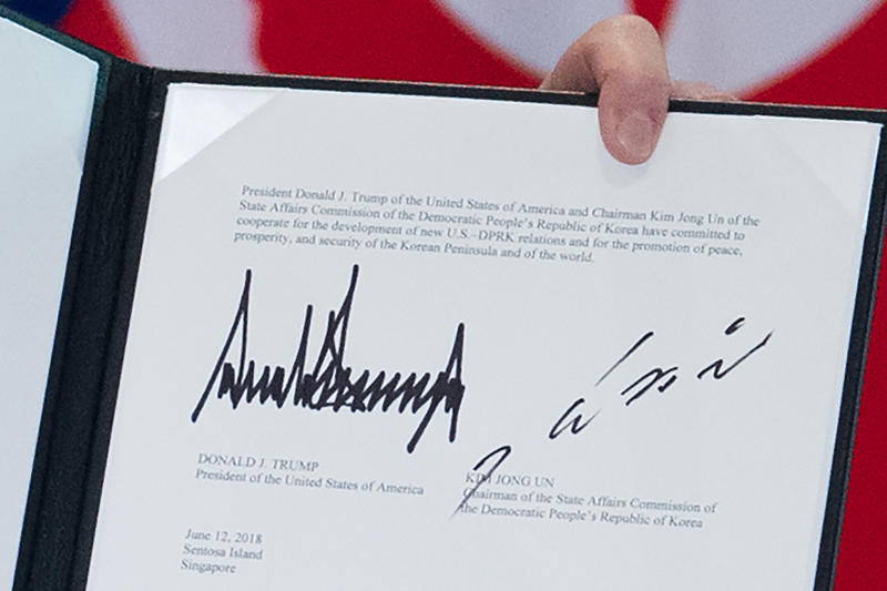 20180613 signing of declaration AFP.jpg
