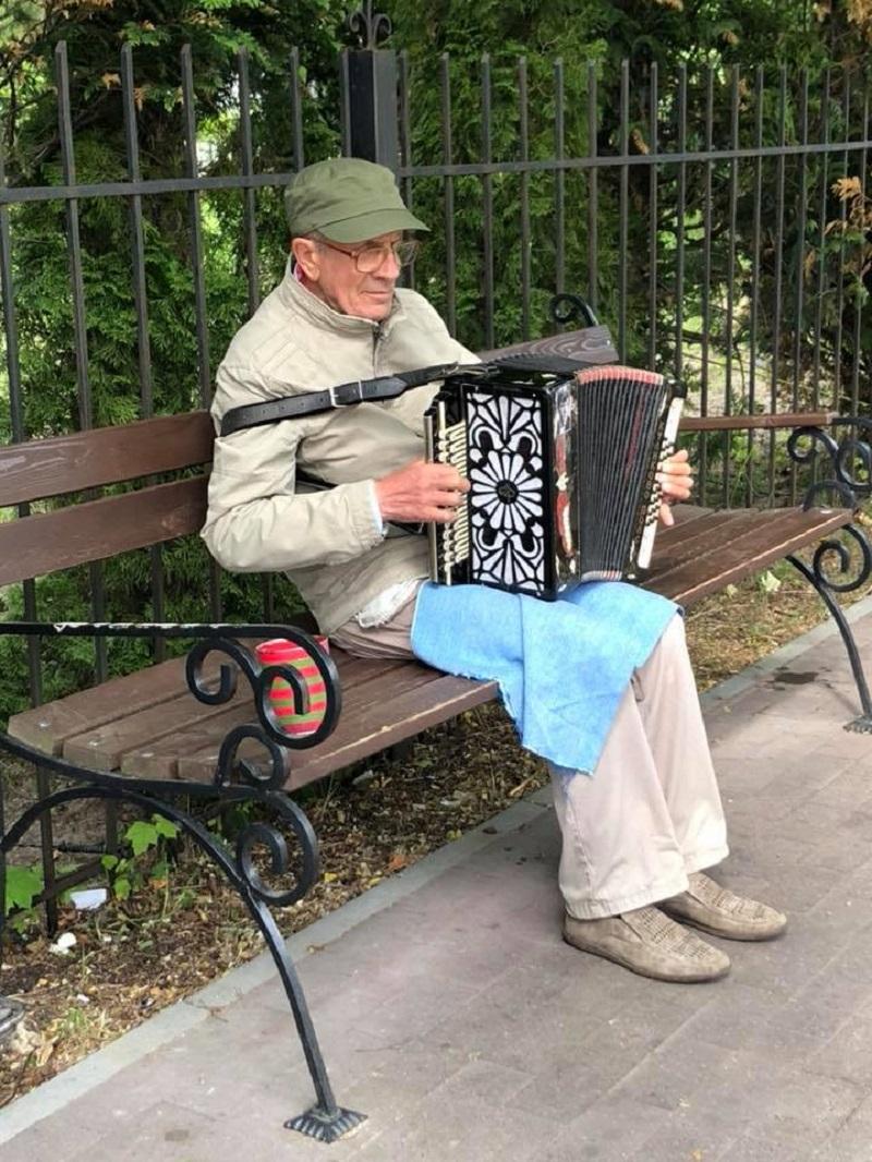 20180614-elderly guy playing music.jpg