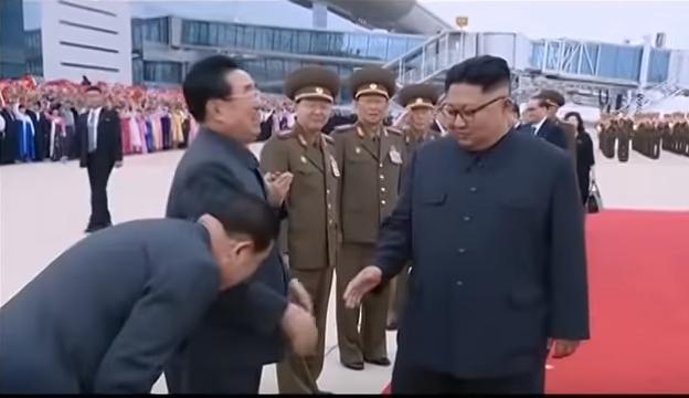 man bow at kim.jpg