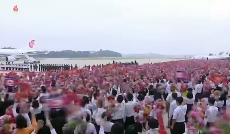 wide shot of crowd cheering at py airport.jpg