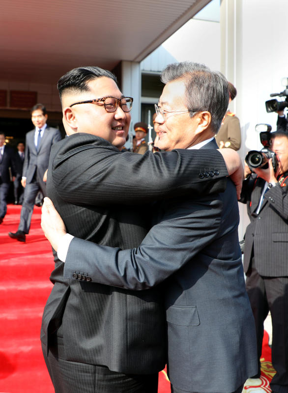 kim and moon hug reuters.jpg