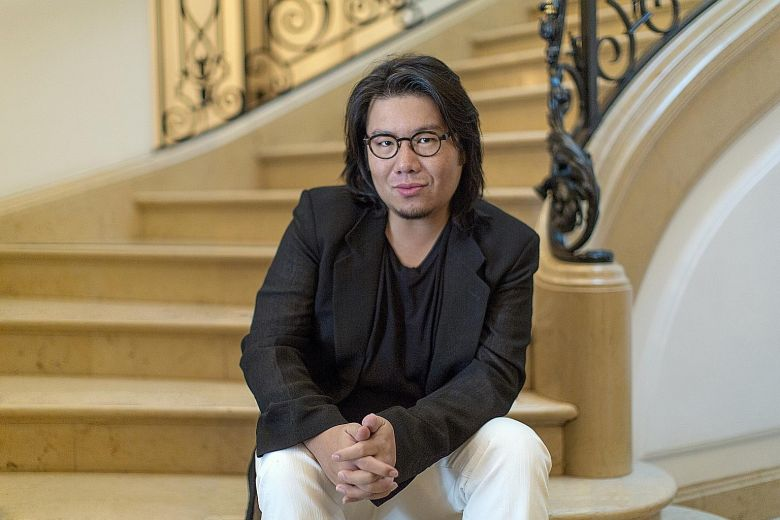 Kevin Kwan on stairs.jpg