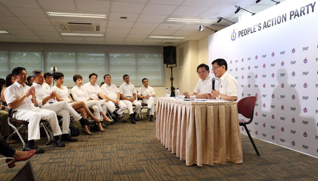 人民行动党于2018年11月23日公布新一届中央执行委员会职务,财政部长王瑞杰(右一)正式出任行动党第一助理秘书长,贸工部长陈振声(右二)担任第二助理秘书长,两人在行动党总部共同主持记者会,分享他们对于未来领导新加坡所持的愿景。