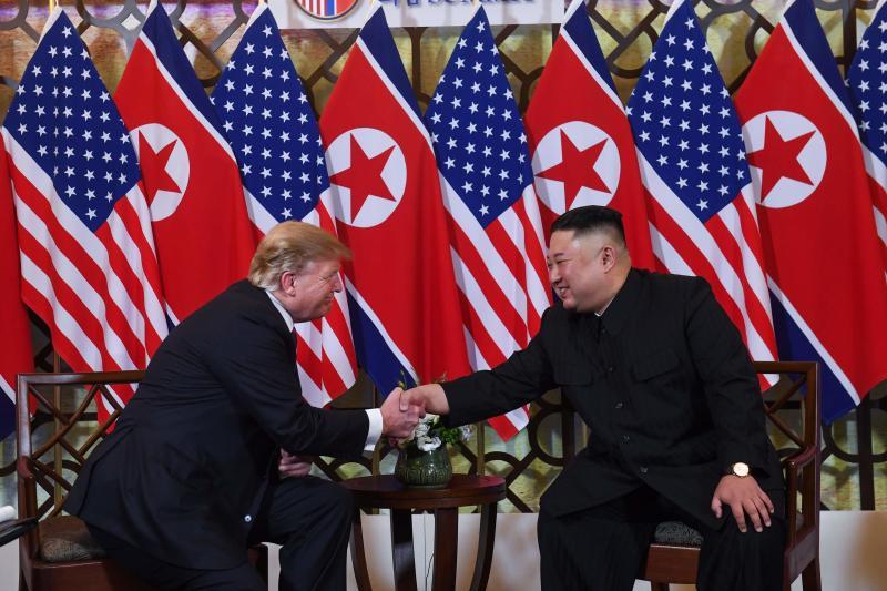 20190227 TKS sits shakes AFP.jpg