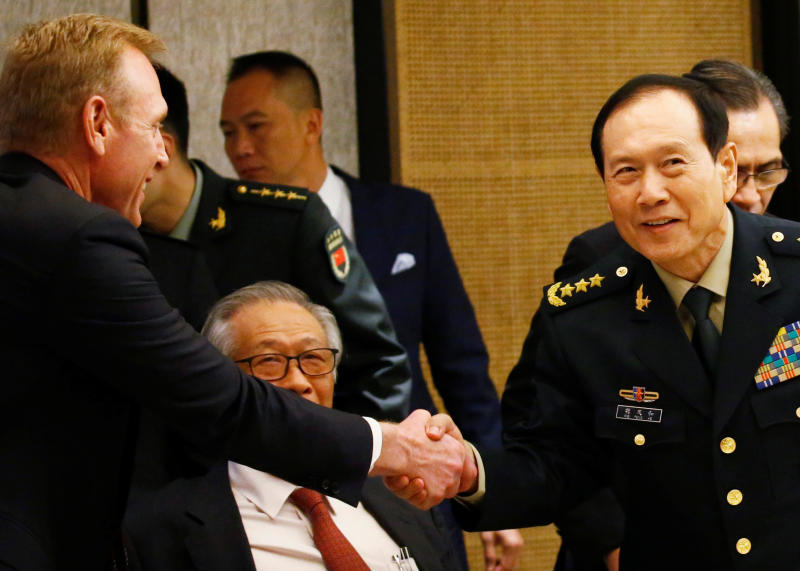 20190603 weifenghe and shanahan and NEH reuters.jpg