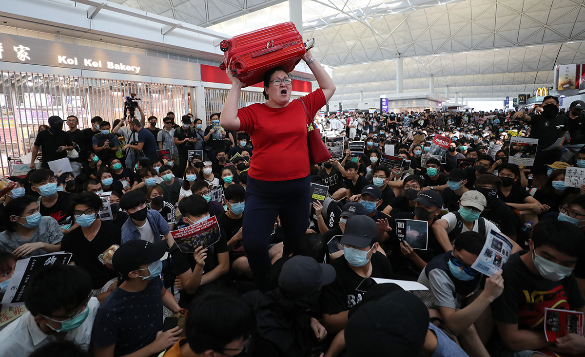 20190815 woman-airport SCMP.jpg
