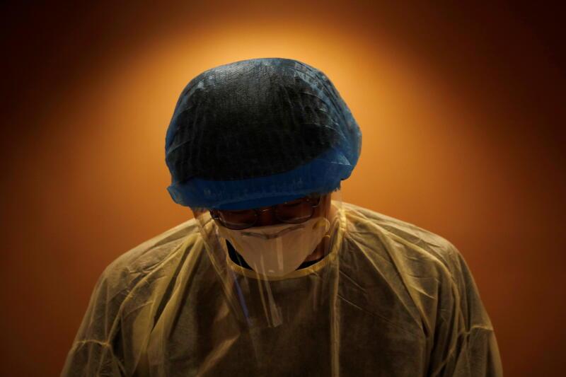 20210301 - Healthcare worker (Reuters).jpg