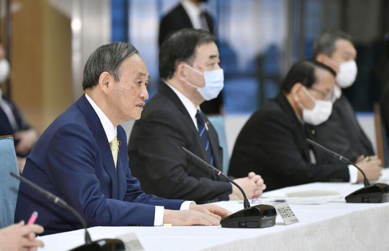20210413 - 日本首相菅义伟出席内阁会议后,召开记者会宣布相关决定。(路透社).jpg