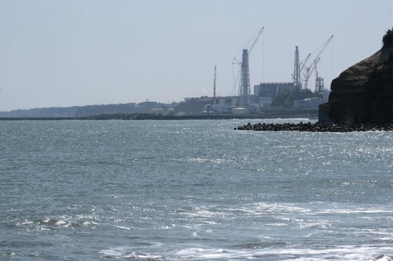 20210413 - This picture taken on March 10, 2021 of the coast of Futaba town, in Fukushima prefecture, shows the Tokyo Electric Power Company Holdings (TEPCO) Fukushima Daiichi nuclear power plant (top) (AFP).jpg