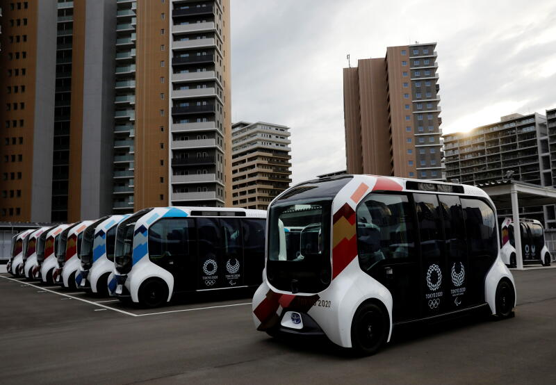 20210622 - Electric vehicles at an internal shuttle bus station (Reuters).jpg