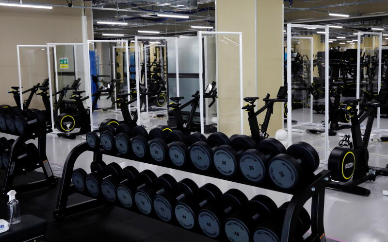 20210622 - Partitions are installed at the fitness center at the multi-function complex (Reuters).jpg