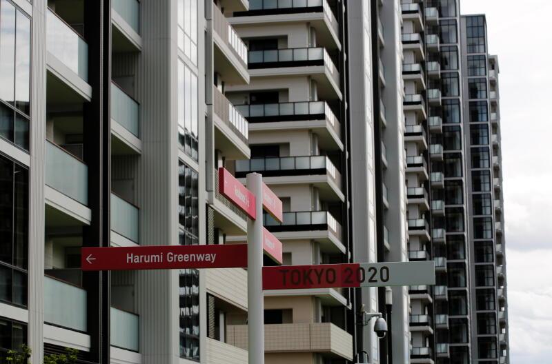 20210622 - Residential buildings are seen behind road signs (Reuters).jpg