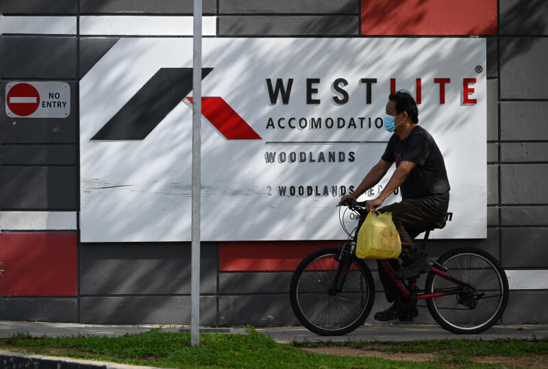 20210625 - Migrant worker cycling outside the Westlite Dormitory Woodlands (ST).jpg