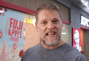 Greg Hadley trying KFC in Singapore
