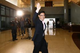 heng swee keat walking into parliament