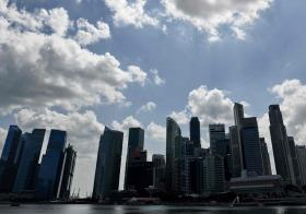 Singapore Skyline under blue skies and white clouds