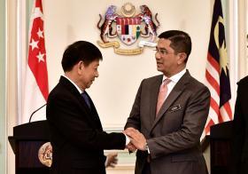 Khaw Boon Wan and Azmin Ali Handshake