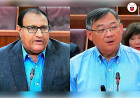 Iswaran and Gan Kim Yong at Parliament
