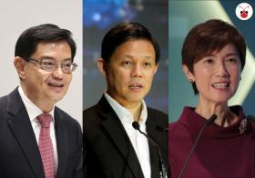 新加坡经济第二季仅增0.1%,十年来最糟,行动党政府出动三内阁部长信心喊话。左起:副总理兼财政部长王瑞杰、贸工部长陈振声、人力部长杨莉明。