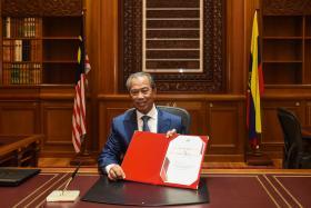 马来西亚第八任首相慕尤丁