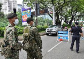 马来西亚出动军队和警察防疫