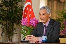 李显龙总理:我们还困在疫情中,出国走动前路还长